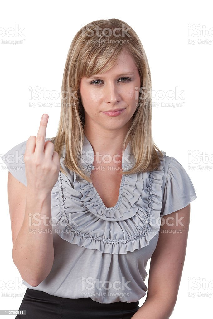 Attractive blond woman making obscene gesture stock photo
