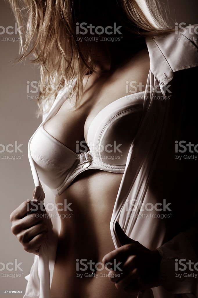 Attractive blond woman undressing royalty-free stock photo