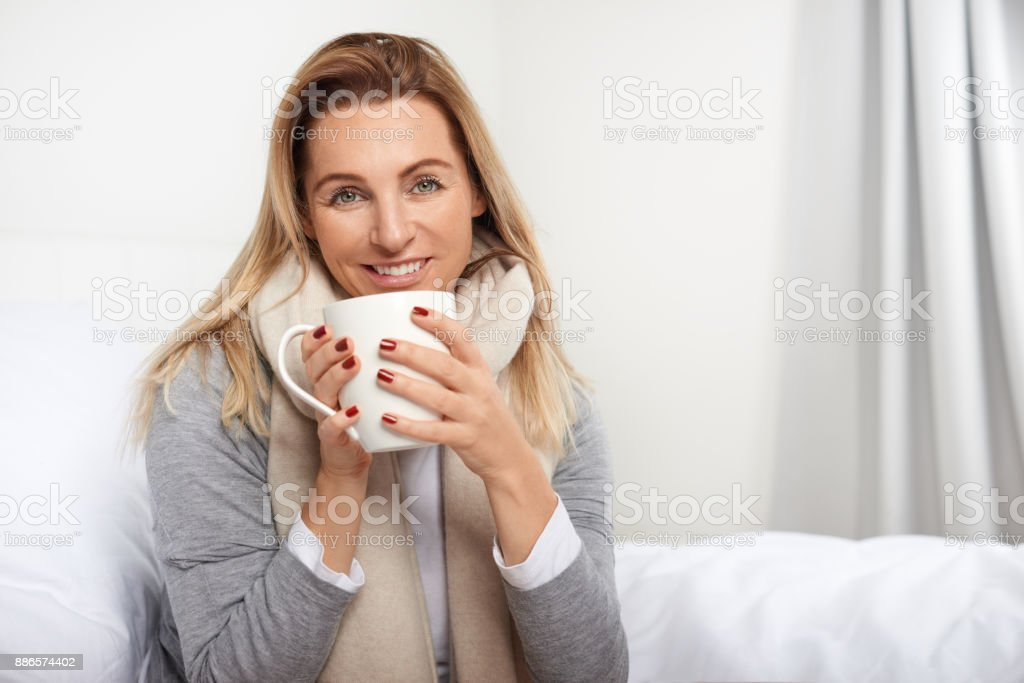 Attractive blond woman with a lovely smile stock photo