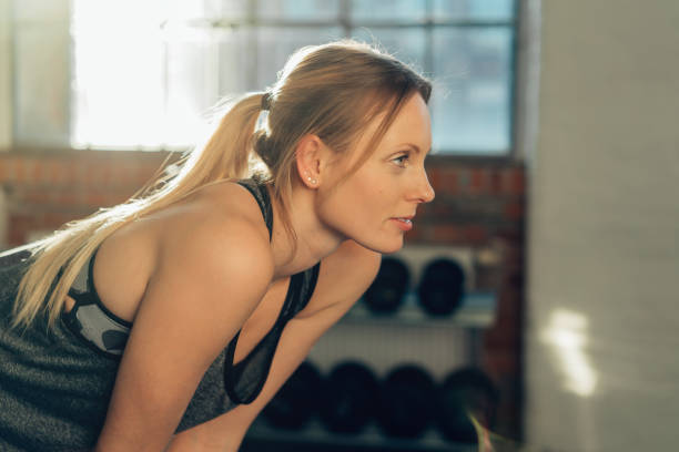 Attractive blond woman working out in a gym stock photo