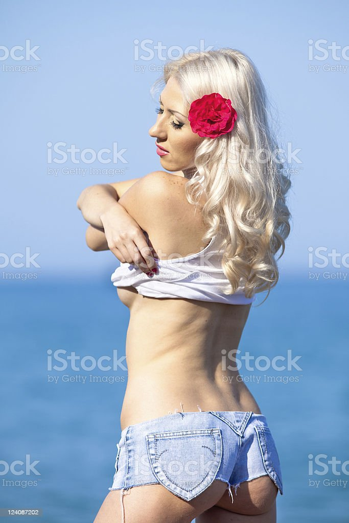 Attractive blonde at the sea stock photo