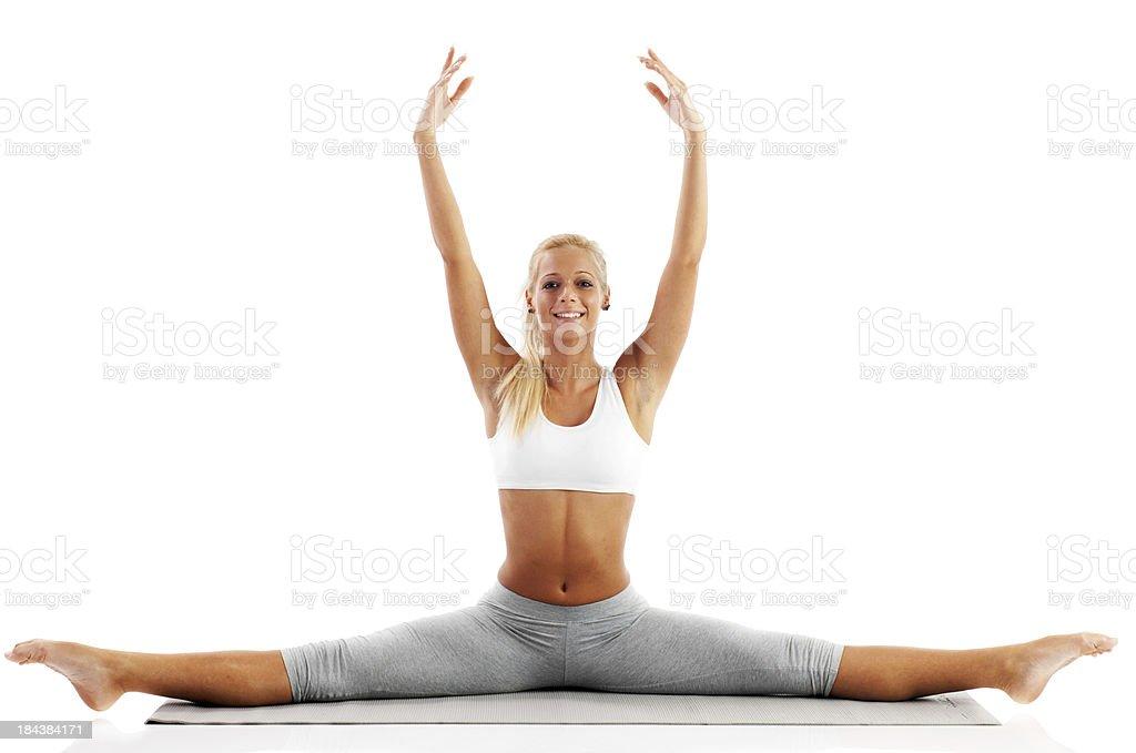 Attractive blonde girl doing gymnastics. stock photo