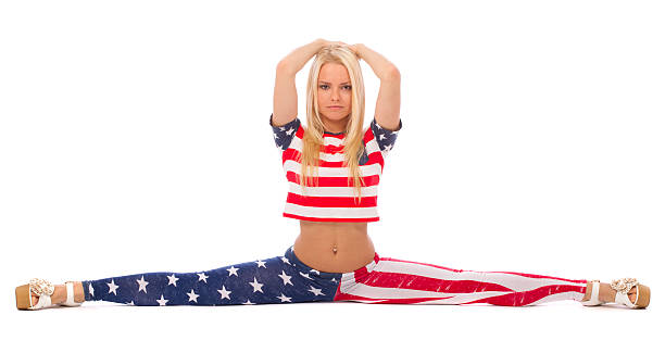 Attractive blonde girl in USA clothes stock photo