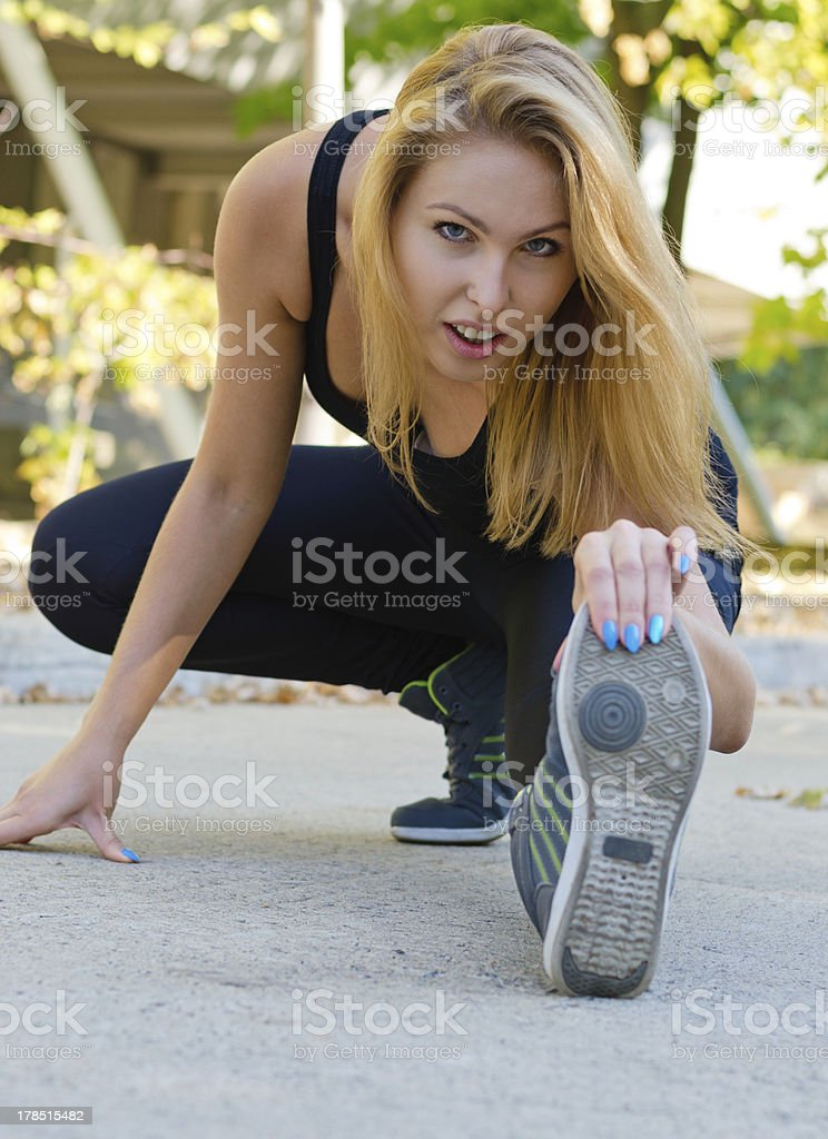Attractive blonde girl working out royalty-free stock photo
