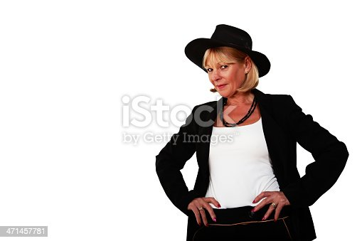 Head and shoulders portrait of attractive blonde mature woman in hat and trouser suit