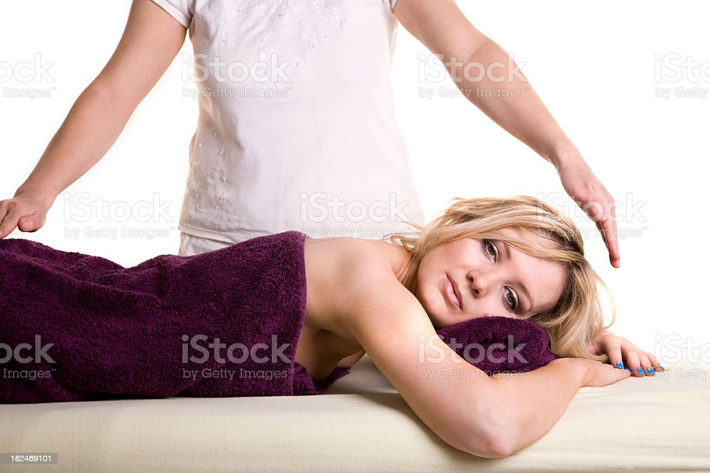 Attractive blonde Young woman having reiki treatment royalty-free stock photo
