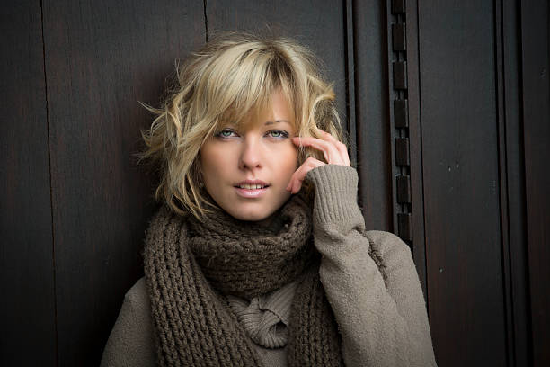 Attractive blonde young woman outdoors, looking at camera stock photo