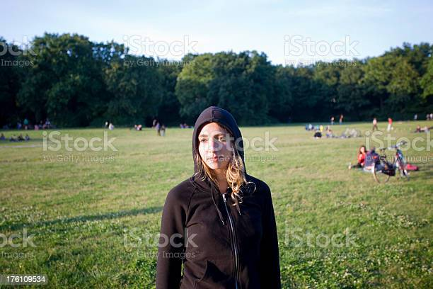 Photo of Attractive Blonde Young Woman wearing a Black Hoody in Park