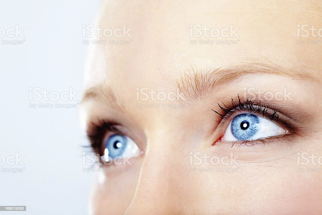 Attractive blue eyes looking up stock photo