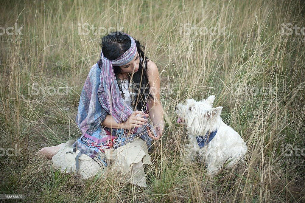 Attractive Bohemian Gypsy Woman with Dog royalty-free stock photo