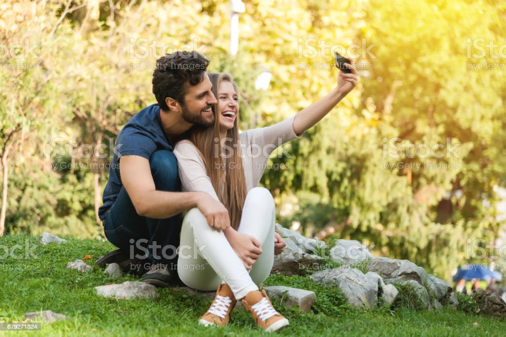Attractive boy and girl couple taking selfie foto de stock royalty-free