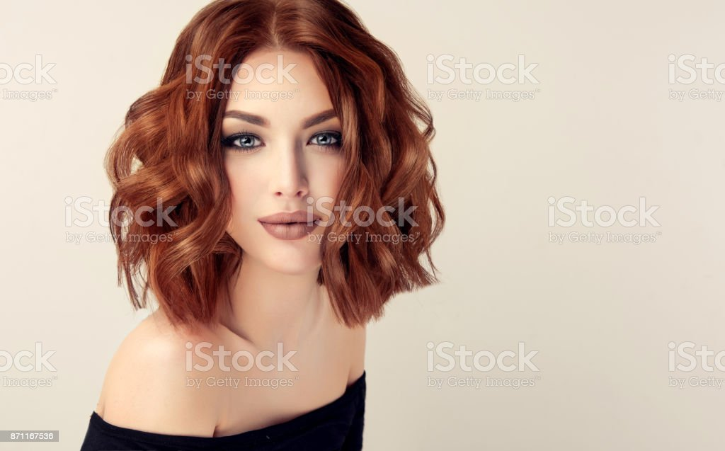 Attractive brown haired  woman  with modern, trendy and elegant hairstyle. - foto stock