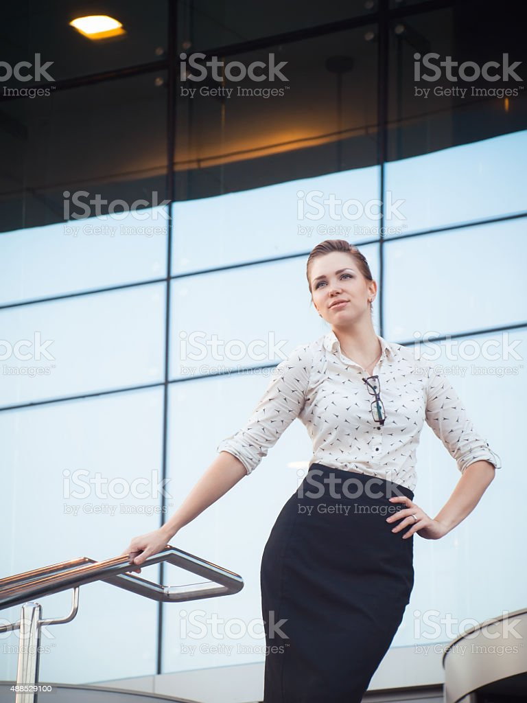 cd9fd127a4 Attractive brunet businesswoman in white blouse and black skirt - Stock  image .