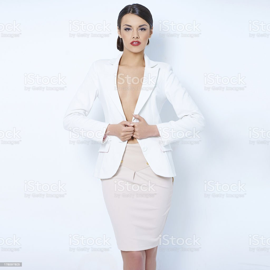 Attractive brunette business woman wearing jacket stock photo