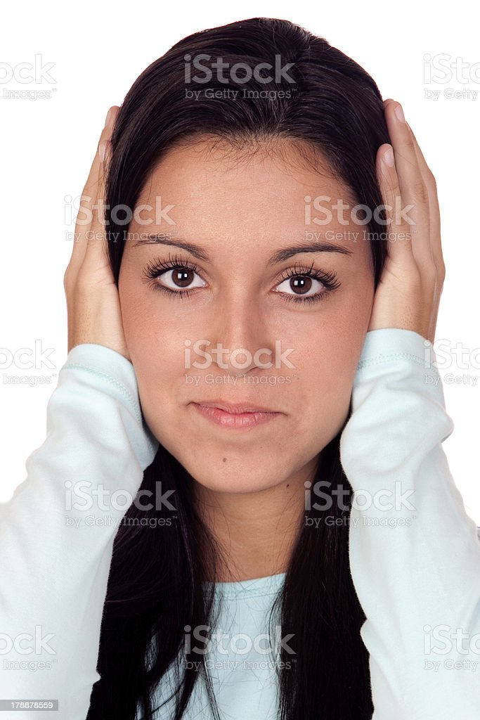 Attractive brunette girl covering her ears royalty-free stock photo