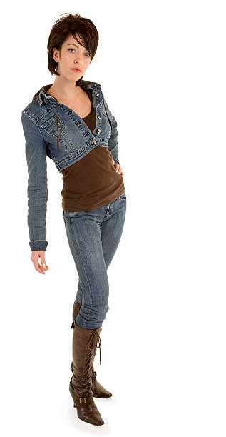 Attractive Brunette Lady Wearing Jeans and Leather Boots stock photo