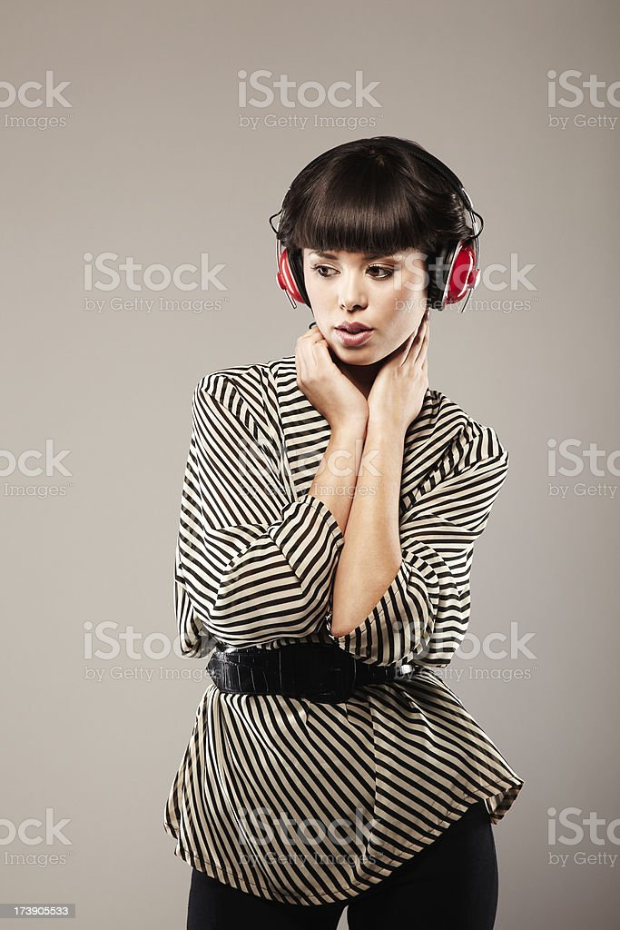 Attractive Brunette Listening to Music on Headphones royalty-free stock photo