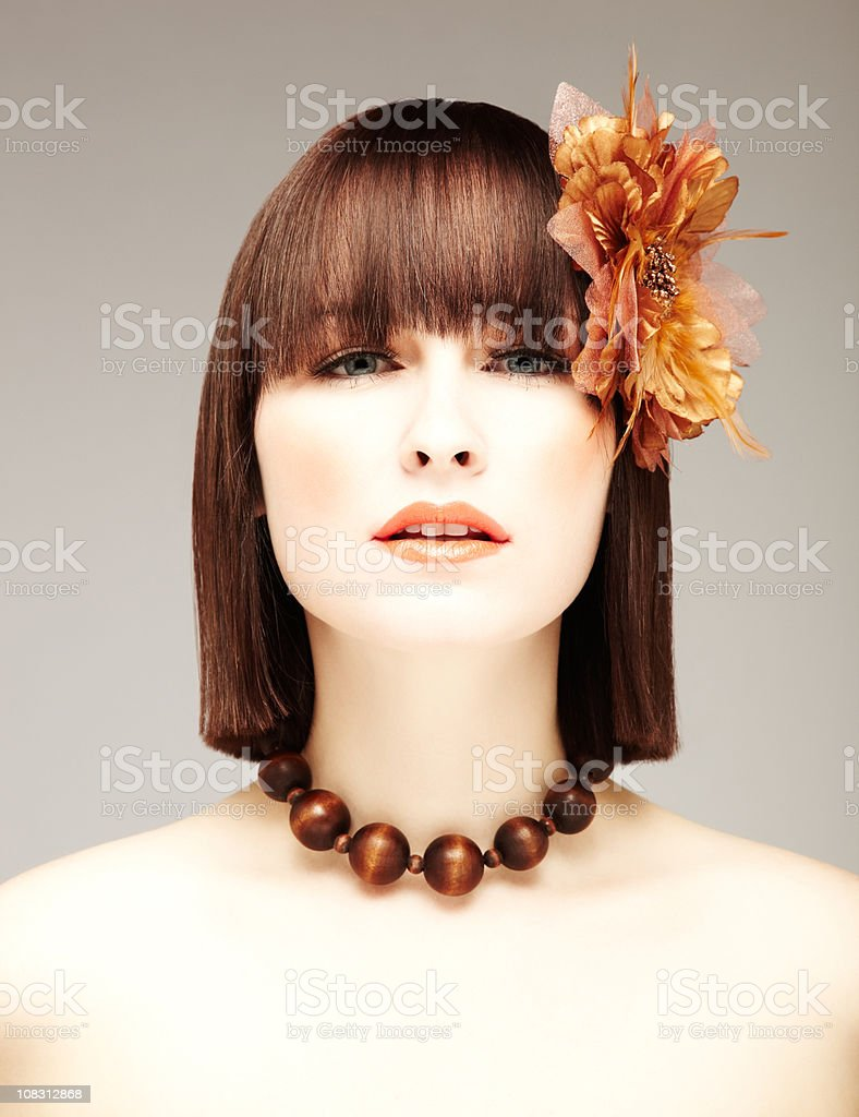 Attractive Brunette with a Flower in her Hair royalty-free stock photo