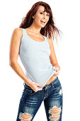 Photo of an attractive young brunette woman in blue tank top and torn jeans; isolated on white.