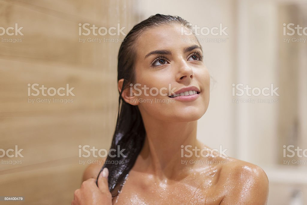 Attractive Brunette Woman Taking Shower Stock Photo