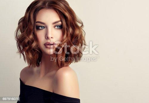 istock Attractive brunette woman with modern, trendy and elegant hairstyle. 697916070