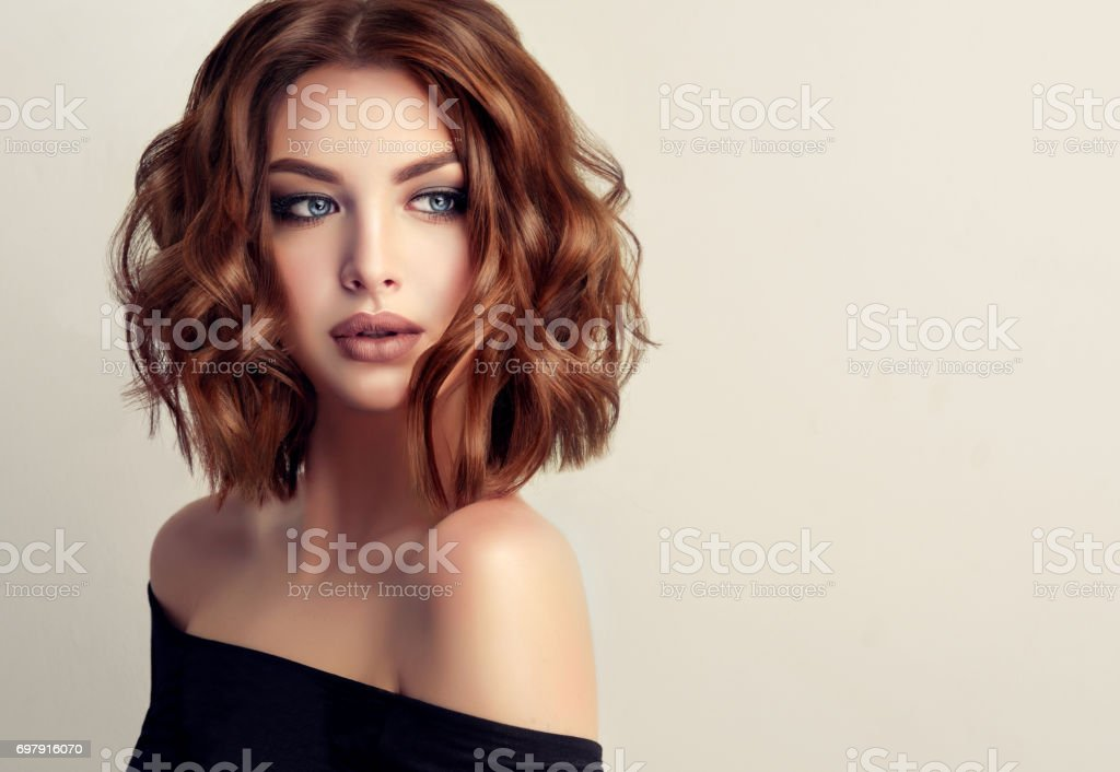 Attractive brunette woman with modern, trendy and elegant hairstyle. stock photo
