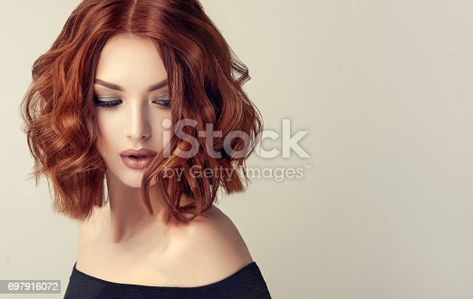 697916070istockphoto Attractive brunette woman with modern, trendy and elegant hairstyle. 697916072