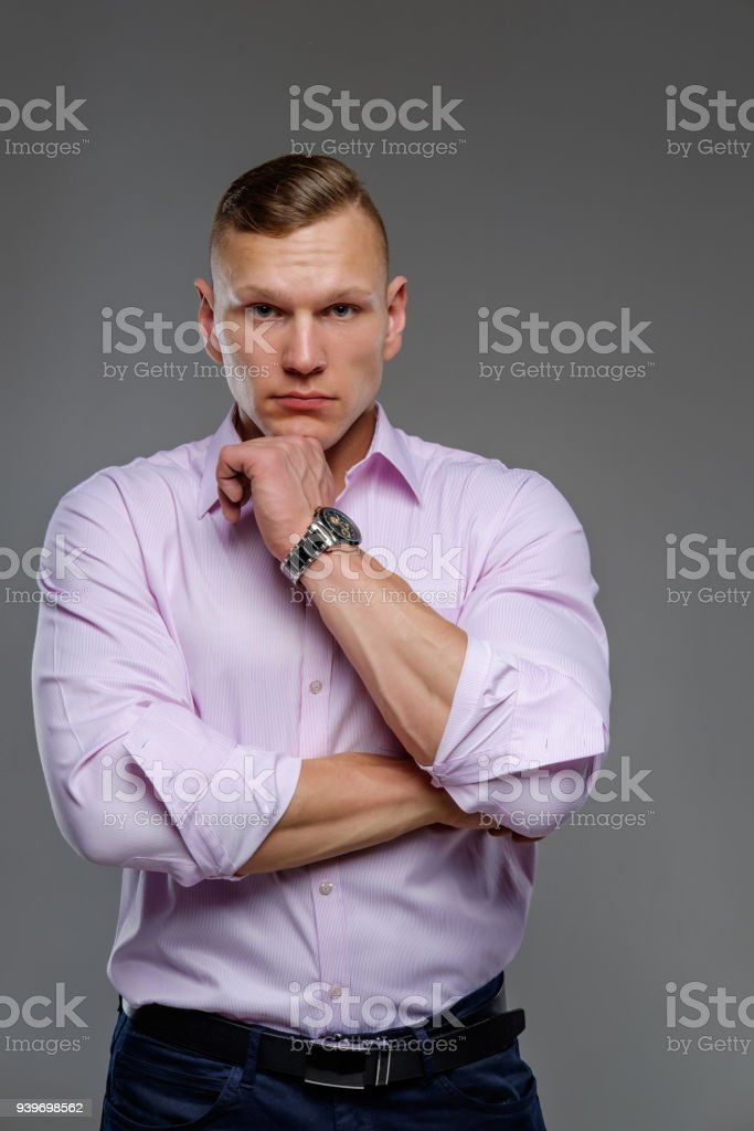 Attractive brutal man in a white shirt. stock photo