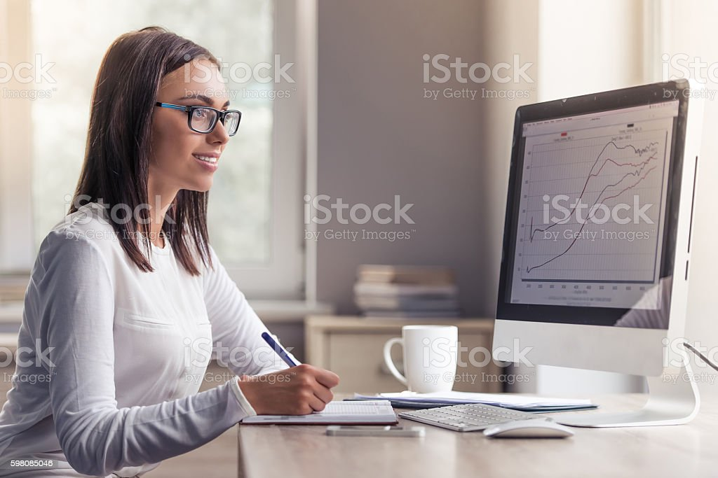 Attractive business lady in office stock photo
