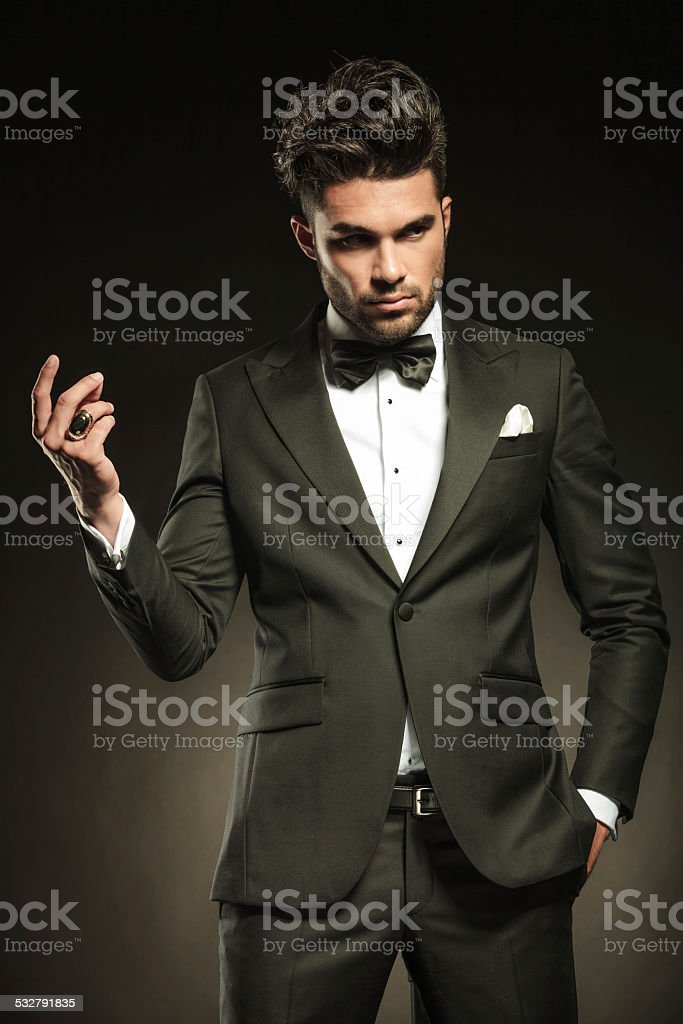 Attractive business man snapping his fingers stock photo