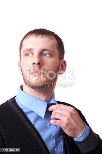istock Attractive business man straightens his tie 473100216