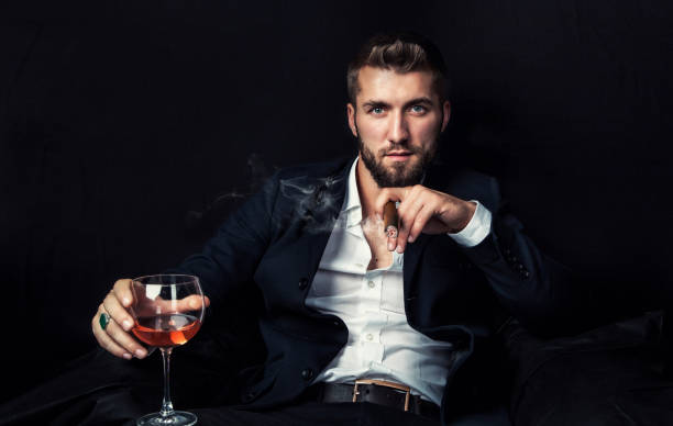 Attractive business man with a cigar and a old whiskey stock photo