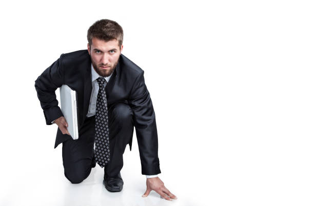 Attractive business man with a notebook under his arm is ready for the start stock photo