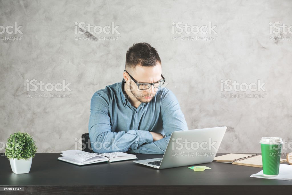 Attractive business man working on project stock photo