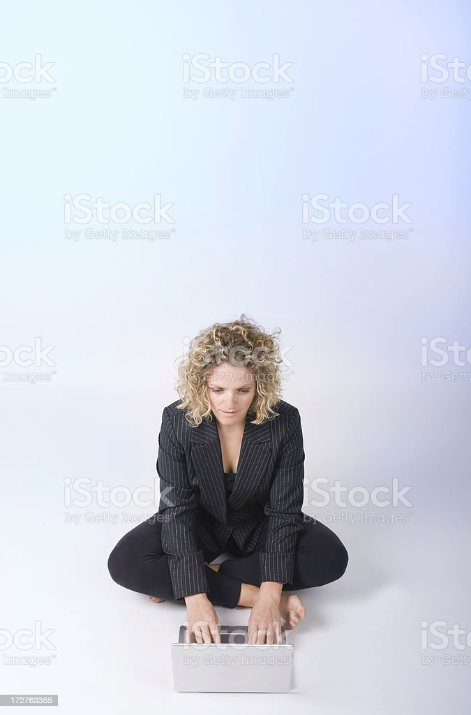 Attractive Business Woman Sits with Computer stock photo