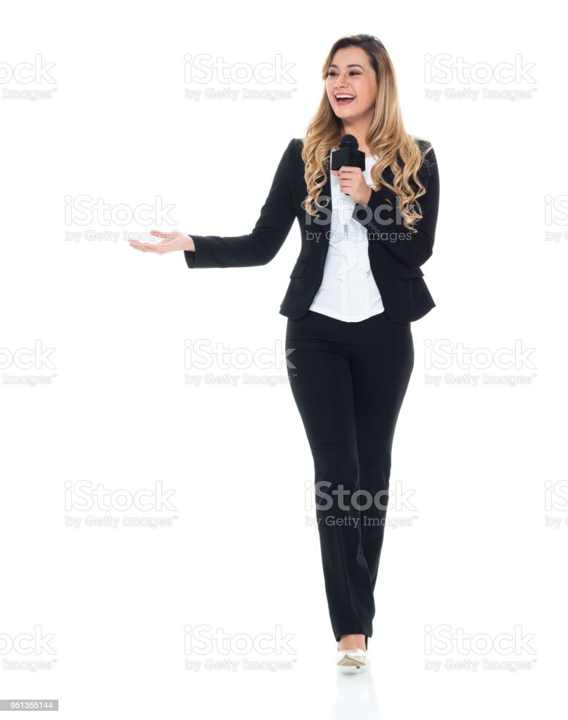 Attractive business woman talking on microphone stock photo