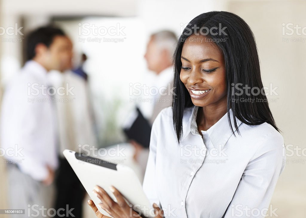 Attractive business woman using electronic tablet royalty-free stock photo