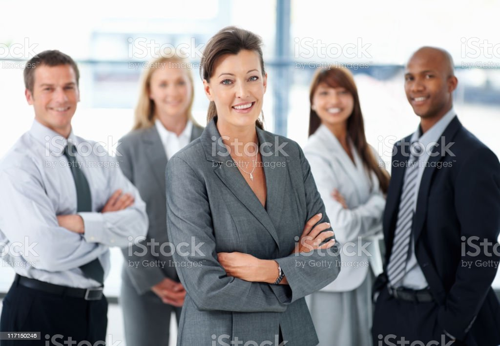 Attractive business woman with her team royalty-free stock photo