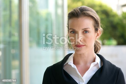 istock Attractive business woman with serious face expression 469395744
