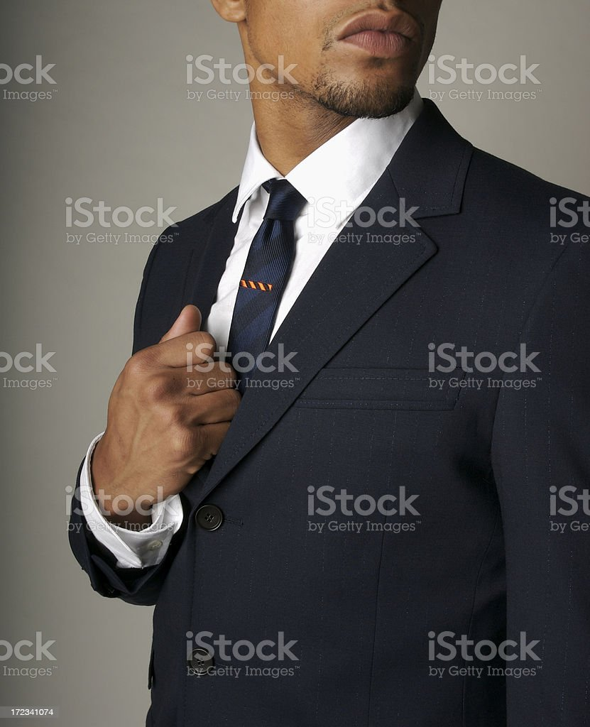 Attractive Businessman African Descent in Fine Navy Suit Close Up stock photo