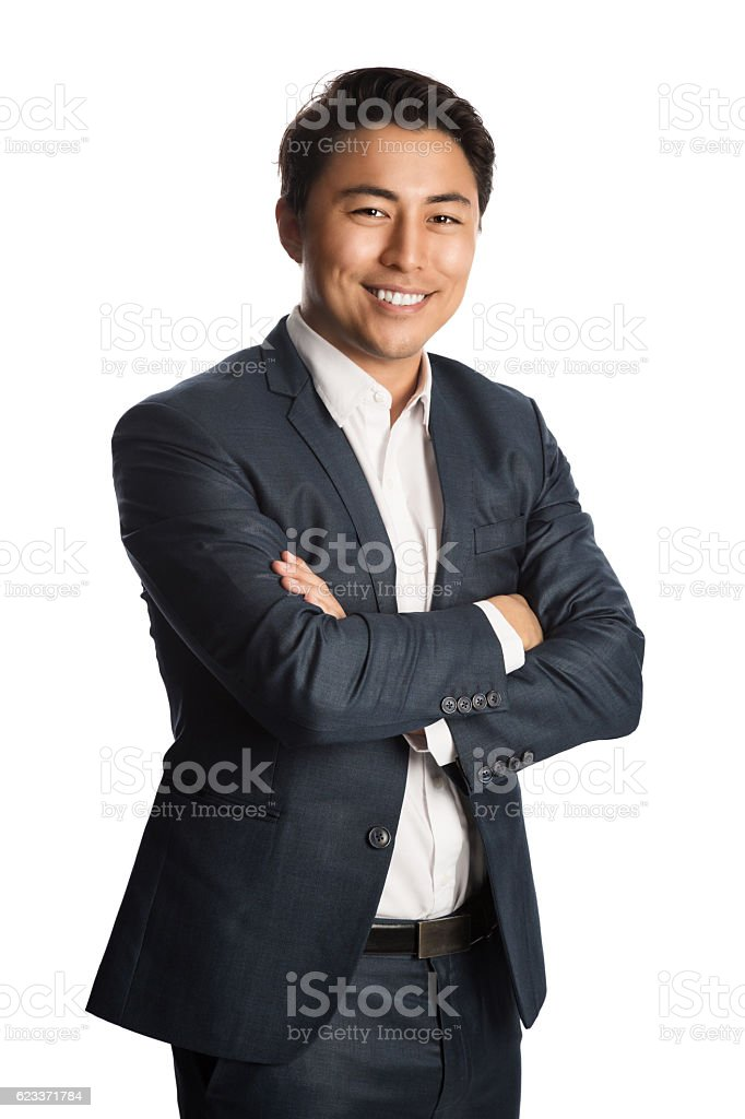 Attractive businessman in blue suit stock photo