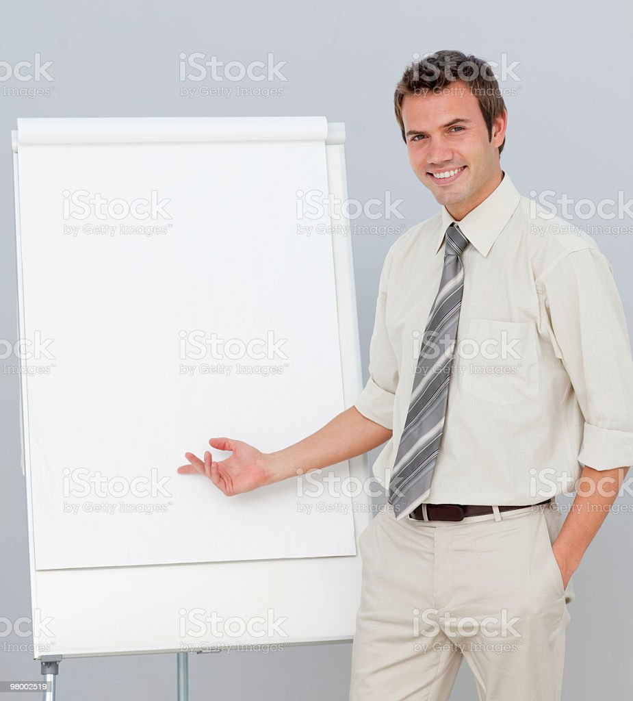 Attractive businessman reporting to sales figures royalty free stockfoto