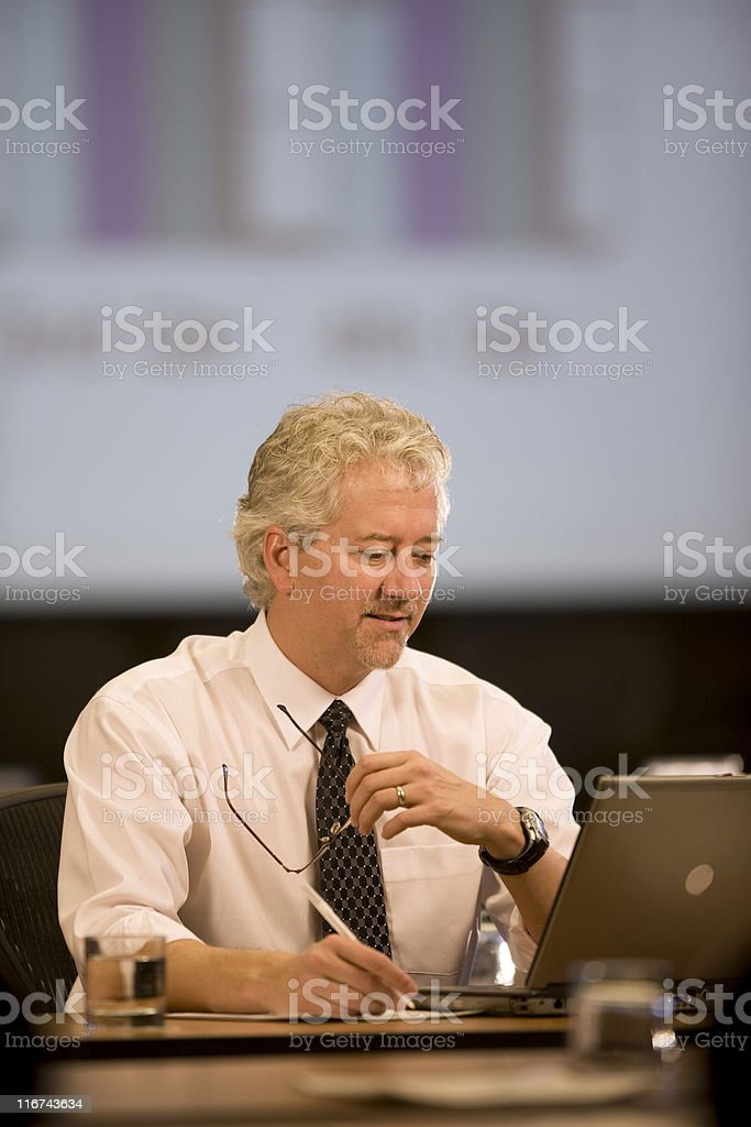 Attractive Businessman Working At His Desk royalty-free stock photo
