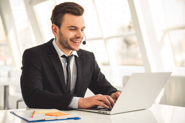 attractive businessman working - call center стоковые фото и изображения