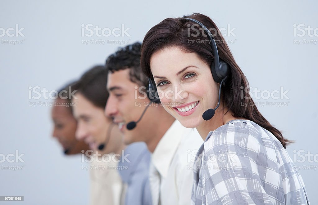 Attractive businesswoman and her team in a call center royalty-free stock photo
