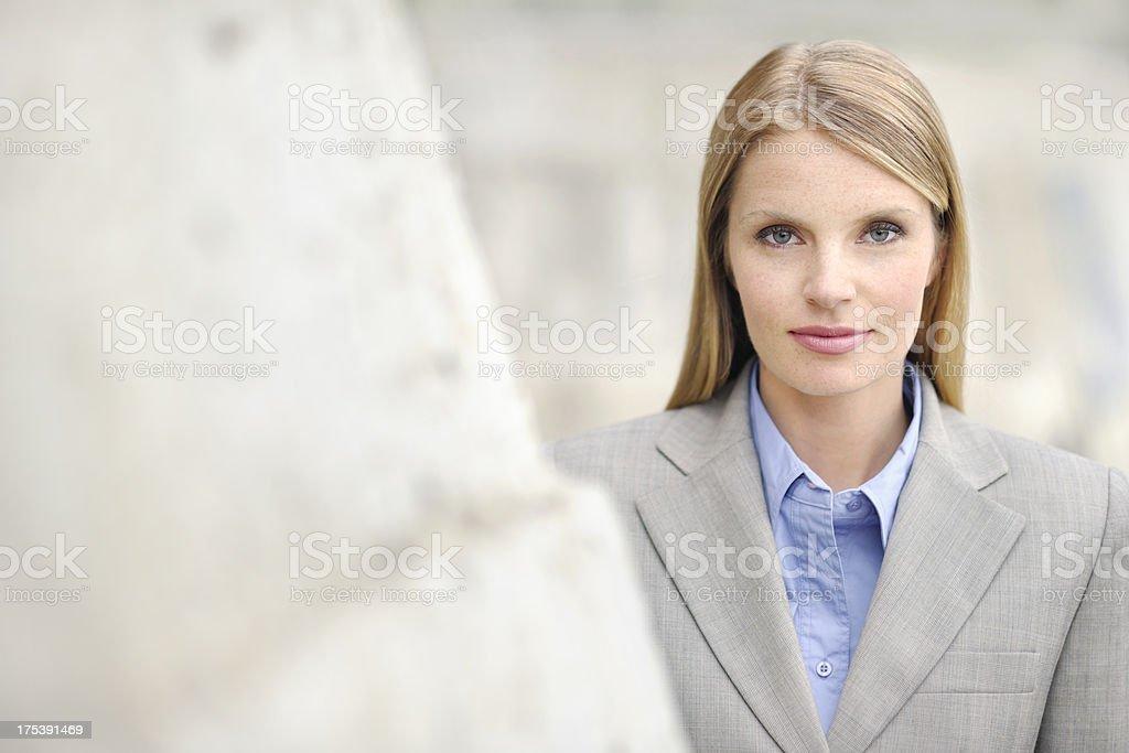 Attractive Businesswoman Beside Building stock photo