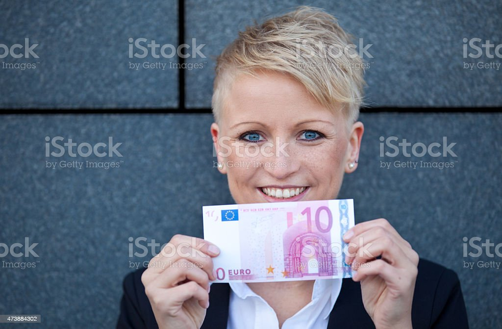Attractive businesswoman holding 10 Euro stock photo