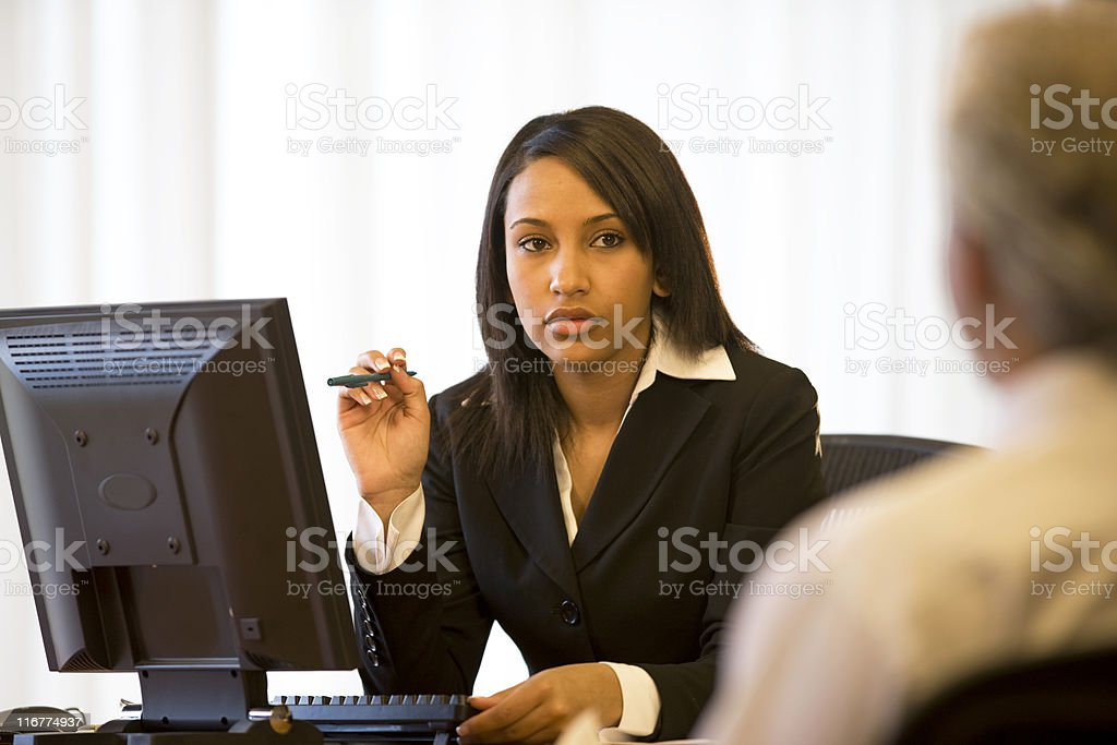 Attractive Businesswoman In Her Office royalty-free stock photo