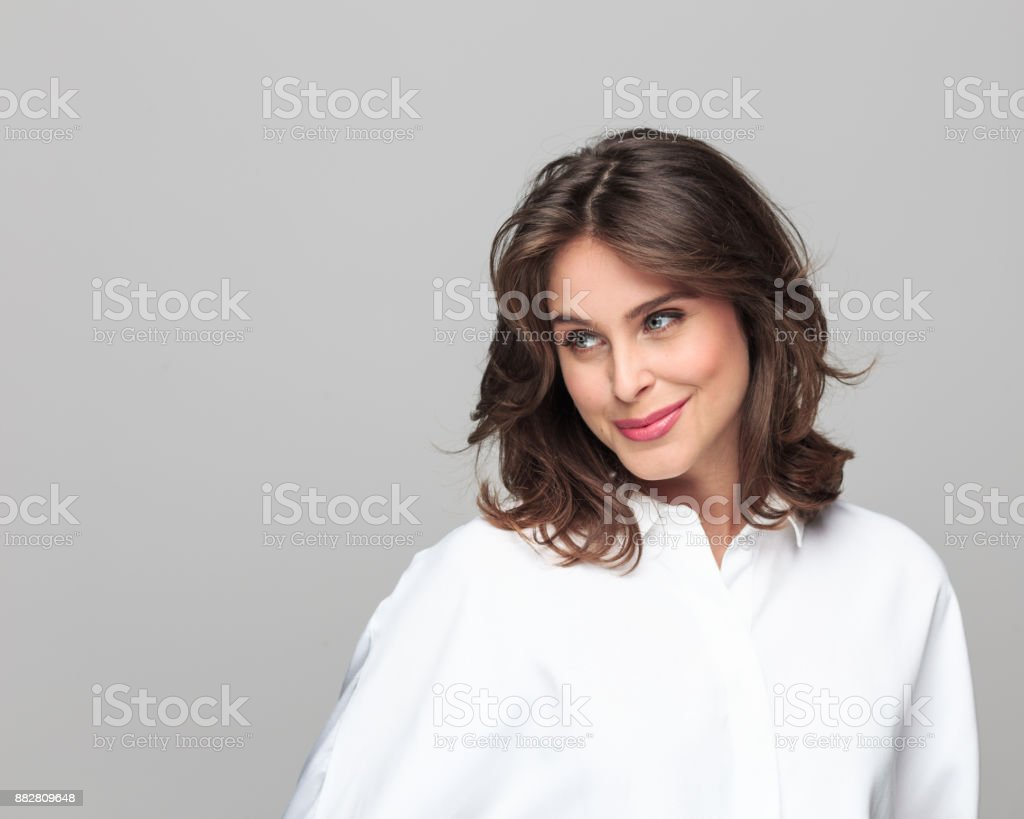 Attractive businesswoman looking away and smiling - Royalty-free 25-29 Years Stock Photo