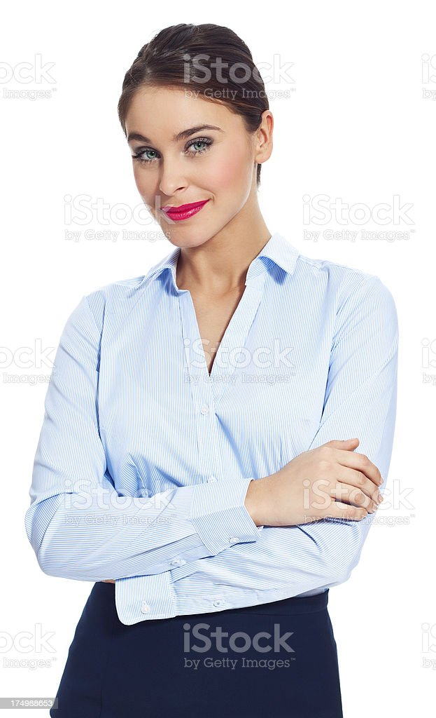 Attractive businesswoman Portrait of confident businesswoman standing against white background with crossed arms and smiling at the camera. 20-24 Years Stock Photo